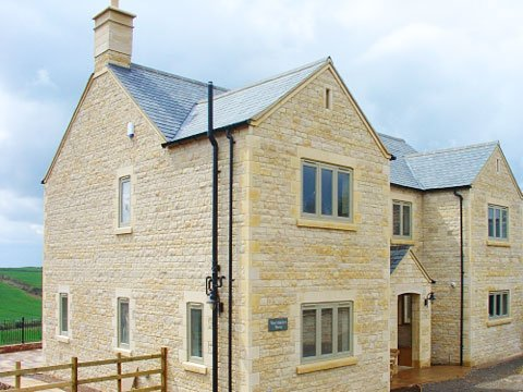 Stormproof wood casement windows by AJB Group