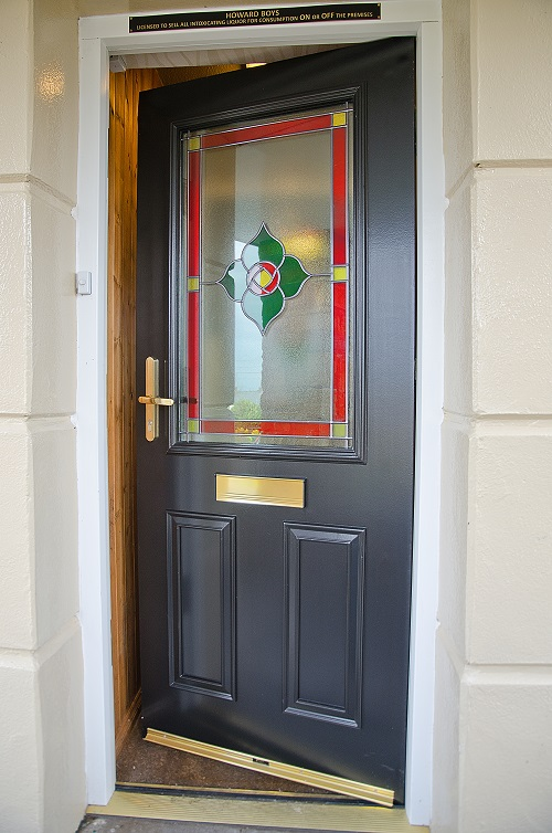 Entrance door with stained glass by West Port Windows & Doors