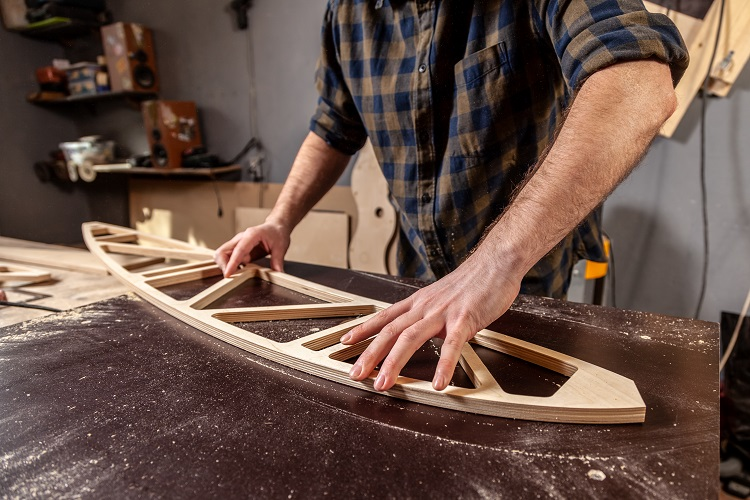 Joiner making an arched window